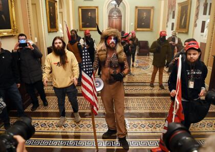 Supporters of US President Donald Trump enter the US Capitol on January 6, 2021, in Washington, DC. - Demonstrators breeched security and entered the Capitol as Congress debated the a 2020 presidential election Electoral Vote Certification. (Photo by Saul LOEB / AFP) (Photo by SAUL LOEB/AFP via Getty Images)