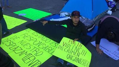 """""""Empezaron a disparar y ahí dejamos todo"""": el drama de cientos de desplazados por grupos armados en México"""