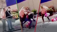 """""""Indignante video"""": Afroamericana golpea a vendedor de flores latino porque quería mercancía gratis"""