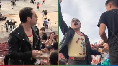 (Video) Disfrazado de Freddie Mercury, asistente a un concierto pone a cantar al público