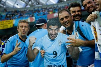 La alegría de los fanáticos enciende los octavos de final entre Uruguay y Portugal