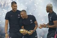 PSG's Kylian Mbappe, center smiles as he holds World Cup trophy prior to League One soccer match between Paris Saint-Germain and Caen at Parc des Princes stadium in Paris, Sunday, Aug. 12, 2018. (AP Photo/Michel Euler)