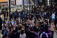 People attend the Beijing Auto Show in Beijing on September 26, 2020. (Photo by Noel CELIS / AFP) (Photo by NOEL CELIS/AFP via Getty Images)