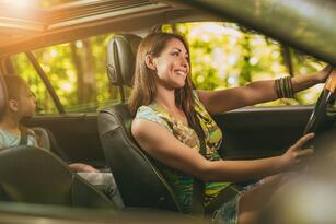 Young,Beautiful,Smiling,Woman,Driving,A,Car.,Her,Cute,Daughter