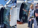 Hombre rompe con sus manos el parabrisas de un camión para rescatar a mujer atrapada dentro