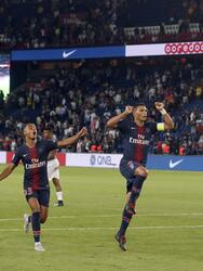 PSG's goalkeeper Gianluigi Buffon, center, and his teammates celebrate victory in their League One soccer match between Paris Saint-Germain and Caen at Parc des Princes stadium in Paris, Sunday, Aug. 12, 2018. (AP Photo/Michel Euler)