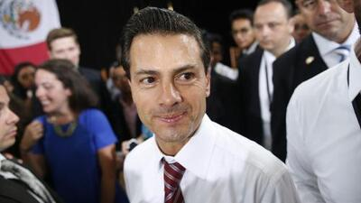 "Le gritan ""asesino"" al presidente Enrique Peña Nieto en Canadá"