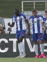 Porto's Danilo Pereira celebrates with teammates scoring the opening goal during the Portuguese league soccer match between Tondela and FC Porto and Leipzig at the Joao Cardoso stadium in Tondela, Portugal, Thursday, July 9, 2020. The Portuguese league soccer matches are being played without spectators because of the coronavirus pandemic. (AP Photo/Luis Vieira)