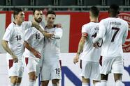 Switzerland's Admir Mehmedi, second left, is congratulated after scoring the opening goal during an international friendly soccer match between Belgium and Switzerland at the King Power stadium in Leuven, Belgium, Wednesday, Nov. 11, 2020. (AP Photo/Francisco Seco)