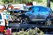 """A tow truck recovers the vehicle driven by golfer Tiger Woods in Rancho Palos Verdes, California, on February 23, 2021, after a rollover accident. - Woods was hospitalized Tuesday after a car crash in which his vehicle sustained """"major damage,"""" the Los Angeles County Sheriff's department said. Woods, the sole occupant, was removed from the wreckage by firefighters and paramedics, and suffered """"multiple leg injuries,"""" his agent said in a statement to US media. (Photo by Frederic J. BROWN / AFP) (Photo by FREDERIC J. BROWN/AFP via Getty Images)"""