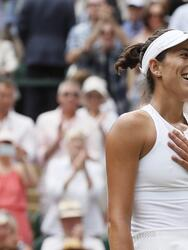 Spain's Garbine Muguruza celebrates after beating Slovakia's Magdalena Rybarikova in their Women's Singles semifinal match on day nine at the Wimbledon Tennis Championships in London Thursday, July 13, 2017. (AP Photo/Kirsty Wigglesworth)