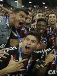 Players of Brazil's Atletico Paranaense celebrate with the trophy after defeating Colombia's Junior 4-3 in a penalty kick shoot-out during the Copa Sudamericana final soccer match at the Arena da Baixada stadium in Curitiba, Brazil, Thursday, Dec. 13, 2018. (AP Photo/Victor Caivano)
