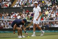 Sam Querrey of the United States reacts after missing a shot to Croatia's Marin Cilic during their Men's Singles semifinal match on day eleven at the Wimbledon Tennis Championships in London, Friday, July 14, 2017. (Nic Bothma/Pool Photo via AP)