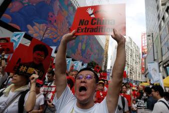 Multitudinaria protesta en Hong Kong en contra de un proyecto de ley que contempla extradiciones a China (fotos)