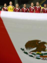 IRBID, JORDAN - OCTOBER 03: Mexico sing their national anthem during the FIFA U-17 Women's World Cup Jordan 2016 Group A match between Jordan and Mexico at Al Hassan International Stadium on October 3, 2016 in Irbid, Jordan. (Photo by Christopher Lee - FIFA/FIFA via Getty Images)