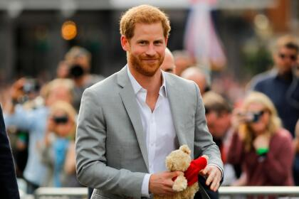 Britain's Prince Harry carries a teddy bear he was given as he greets well-wishers on the street outside Windor Castle in Windsor on May 18, 2018, the eve of Prince Harry's royal wedding to US actress Meghan Markle. - Britain's Prince Harry and US actress Meghan Markle will marry on May 19 at St George's Chapel in Windsor Castle. (Photo by Tolga AKMEN / AFP) (Photo credit should read TOLGA AKMEN/AFP/Getty Images)