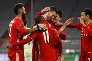 MUNICH, GERMANY - DECEMBER 09: Niklas Suele of FC Bayern Munich celebrates with team mates Douglas Costa, Eric Maxim Choupo-Moting, Marc Roca and Jamal Musiala (R) after scoring their sides first goal during the UEFA Champions League Group A stage match between FC Bayern Muenchen and Lokomotiv Moskva at Allianz Arena on December 09, 2020 in Munich, Germany. Sporting stadiums around Germany remain under strict restrictions due to the Coronavirus Pandemic as Government social distancing laws prohibit fans inside venues resulting in games being played behind closed doors. (Photo by Alexander Hassenstein/Getty Images)