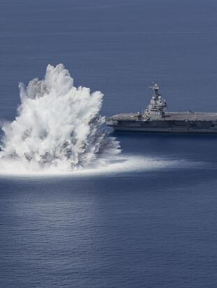 The aircraft carrier USS Gerald R. Ford (CVN 78) completes the first scheduled explosive event of Full Ship Shock Trials while underway in the Atlantic Ocean, June 18, 2021. The U.S. Navy conducts shock trials of new ship designs using live explosives to confirm that our warships can continue to meet demanding mission requirements under harsh conditions they might encounter in battle. (U.S. Navy photo by Mass Communications Specialist Seaman Jackson Adkins)