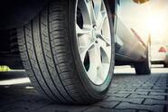 Car,All-season,Tire,Close,Up,,Parked,Car.,Low,Angle,Shot,