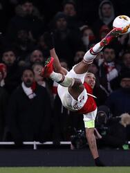 Arsenal's Gabonese striker Pierre-Emerick Aubameyang (L) scores their late goal in extra-time during the UEFA Europa league round of 32 second leg football match between Arsenal and Olympiakos at the Emirates stadium in London on February 27, 2020. (Photo by Adrian DENNIS / AFP) (Photo by ADRIAN DENNIS/AFP via Getty Images)