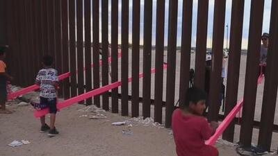 Familias se divierten entre el muro fronterizo que los divide entre México y EEUU