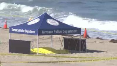 En fotos: hallan a dos hombres muertos en popular playa del sur de California