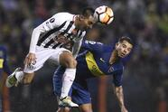 Angel Lucena of Paraguay's Libertad, left, heads the ball alongside Edwin Cardona Argentina's Boca Juniors during a Copa Libertadores soccer match in Buenos Aires, Argentina, Wednesday, Aug. 8, 2018. (AP Photo/Gustavo Garello)
