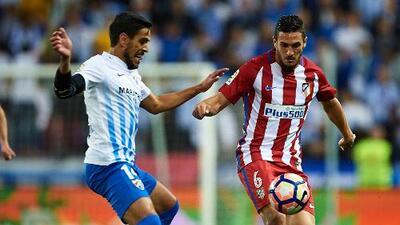 Atlético hunde al Málaga y presiona al Sevilla