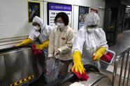 "SEOUL, SOUTH KOREA - FEBRUARY 28: Disinfection professionals wearing protective gear spray anti-septic solution against the coronavirus (COVID-19) at a sybway station on February 28, 2020 in Seoul, South Korea. Government has raised the coronavirus alert to the ""highest level"" as confirmed case numbers keep rising. Government reported 571 new cases of the coronavirus (COVID-19) bringing the total number of infections in the nation to 2,337 with the potentially fatal illness spreading fast across the country. (Photo by Chung Sung-Jun/Getty Images)"