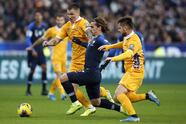 France's Antoine Griezmann, center, fights for the ball with Moldova's Veaceslav Posmac, left, and Moldova's Catalin Car, right, during the Euro 2020 group H qualifying soccer match between France and Moldova at the Stade de France stadium, in Saint Denis, north of Paris, Thursday, Nov. 14, 2019. (AP Photo/Francois Mori)