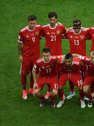 Players from the Russian national football team pose for a group photo from back left: Russia's forward Fedor Smolov, Russia's midfielder Alexander Erokhin, Russia's defender Fedor Kudryashov, Russia's defender Viktor Vasin, Russia's defender Georgiy Dzhikiya, Russia's goalkeeper Igor Akinfeev and bottom row from left: Russia's midfielder Alexander Golovin, Russia's midfielder Alexander Samedov, Russia's midfielder Denis Glushakov, Russia's forward Dmitry Poloz, and Russia's midfielder Yury Zhirkov during the 2017 Confederations Cup group A football match between Russia and New Zealand at the Krestovsky Stadium in Saint-Petersburg on June 17, 2017. (Photo by FRANCOIS XAVIER MARIT / AFP) (Photo credit should read FRANCOIS XAVIER MARIT/AFP/Getty Images)