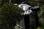 """The vehicle driven by golfer Tiger Woods lies on its side in Rancho Palos Verdes, California, on February 23, 2021, after a rollover accident. - US golfer Tiger Woods was hospitalized Tuesday after a car crash in which his vehicle sustained """"major damage,"""" the Los Angeles County Sheriff's department said. Woods, the sole occupant, was removed from the wreckage by firefighters and paramedics, and suffered """"multiple leg injuries,"""" his agent said in a statement to US media. (Photo by Patrick T. FALLON / AFP) (Photo by PATRICK T. FALLON/AFP via Getty Images)"""