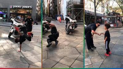 (Video) Policía baila 'breakdance' con un niño y Don Tela lo critica por poner en riesgo la seguridad