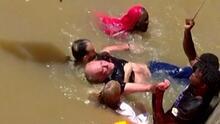 El momento en el que un inmigrante se lanza al agua para salvar a un hombre que se ahogaba