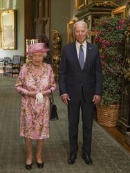 Britain's Queen Elizabeth II with US President Joe Biden and First Lady Jill Biden in the Grand Corridor at Windsor Castle, Windsor, England, Sunday June 13, 2021. The queen hosted the president and first lady Jill Biden at Windsor Castle, her royal residence near London. Biden flew to London after wrapping up his participation in a three-day summit of leaders of the world's wealthy democracies in Cornwall, in southwestern England. (Steve Parsons/Pool via AP)