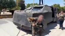 Presuntos miembros del CJNG exhiben dos blindados caseros como trofeos de guerra en Michoacán
