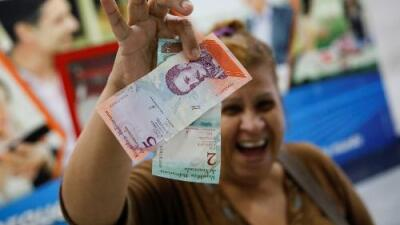 La misma hiperinflación pero con cinco ceros menos: Venezuela estrena moneda en medio de la crisis