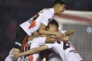 Argentina's River Plate celebrate their side's first goal, by Ignacio Fernandez, during a Copa Libertadores soccer match against Paraguay's Cerro Porteño in Buenos Aires, Argentina, Thursday, Aug. 22, 2019. (AP Photo/Gustavo Garello)