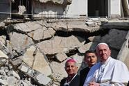 "TOPSHOT - Pope Francis (R), accompanied by the Chaldean Catholic Archbishop of Mosul Najib Michaeel Moussa (L), looks on at a square near the ruins of the Syriac Catholic Church of the Immaculate Conception (al-Tahira-l-Kubra), in the old city of Iraq's northern Mosul on March 7, 2021. - Pope Francis, on his historic Iraq tour, visits today Christian communities that endured the brutality of the Islamic State group until the jihadists' ""caliphate"" was defeated three years ago (Photo by Vincenzo PINTO / AFP) (Photo by VINCENZO PINTO/AFP via Getty Images)"