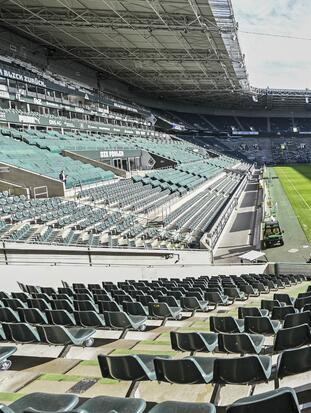 Empty seats are pictured at the stadium of German Bundesliga soccer club Borussia Moenchengladbach in Moenchengladbach, Germany, Thursday, April 16, 2020. All major events in Germany are suspended due to the coronavirus outbreak until the end of August, the German Bundesliga suspended all matches until April 30, 2020. (AP Photo/Martin Meissner)