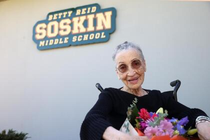 EL SOBRANTE, CALIFORNIA - SEPTEMBER 22: Betty Reid Soskin, the oldest full-time National Park Service ranger in the United States, sits in front of a sign during a ceremony for the newly renamed Betty Reid Soskin Middle School on September 22, 2021 in El Sobrante, California. Soskin had the school renamed after her on her 100th birthday. She currently works at the Rosie the Riveter/World War II Home Front National Historical Park where she leads tours, speaks to groups and answers questions about living and working in the area during World War Two. Soskin worked as a clerk for the Boilermakers A-36 in Richmond, California during the war. (Photo by Justin Sullivan/Getty Images)