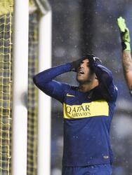 Ramon Abila of Argentina's Boca Juniors, left, reacts after missing a shot against Paraguay's Libertad, during a Copa Libertadores soccer match in Buenos Aires, Argentina, Wednesday, Aug. 8, 2018. (AP Photo/Gustavo Garello)