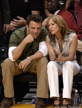 LOS ANGELES, CA - MAY 11: (FILE PHOTO) Actor Ben Affleck (L) and his fiance actress/singer Jennifer Lopez attend the Los Angeles Lakers v. San Antonio Spurs playoff game at the Staples Center May 11, 2003 in Los Angeles, California. Lopez and Affleck postponed their wedding, which was scheduled for this weekend, and has now reportedly spit up, possibly temporarily. (Photo by Vince Bucci/Getty Images)