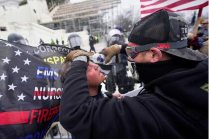 A demonstrator has his eyes flushed with water after confronting police, Wednesday, Jan. 6, 2021, at the Capitol in Washington. As Congress prepares to affirm President-elect Joe Biden's victory, thousands of people have gathered to show their support for President Donald Trump and his claims of election fraud. (AP Photo/Julio Cortez)