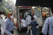 Health workers prepare to take out bodies of six victims of COVID-19 from an ambulance for cremation in New Delhi, India, Monday, April 19, 2021. India has been overwhelmed by hundreds of thousands of new coronavirus cases daily, bringing pain, fear and agony to many lives as lockdowns have been placed in Delhi and other cities around the country. (AP Photo/Manish Swarup)