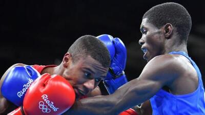 El colombiano Yurbenjen Martínez avanzó en boxeo, México y Venezuela debutan con derrotas