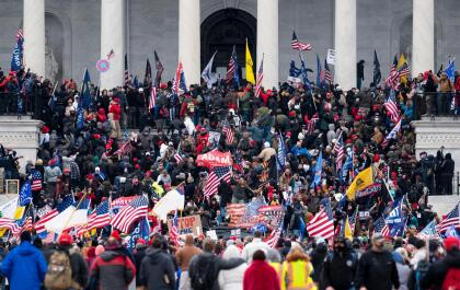 UNITED STATES - JANUARY 6: Trump supporters take over the steps of the Capitol on Wednesday, Jan. 6, 2021, as the Congress works to certify the electoral college votes. (Photo By Bill Clark/CQ-Roll Call, Inc via Getty Images)