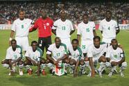 MONTPELLIER, FRANCE - AUGUST 17: Ivory Coast team line up prior to the International Friendly match between France and Ivory Coast at the Mosson Stadium on August 17, 2005 in Montpellier, France. Back row left to right: Bonaventure Kalou, Jean-Jacques Tizie, Marc Zoro, Dindane Aruna, Kolo Abib Toure. Front row left to right: Yapo Gilles Yapi, Arthur Boka, Cyrille Domoraud, Didier Zokora,Didier Drogba, Siaka Tiene. (Photo by Shaun Botterill/Getty Images)