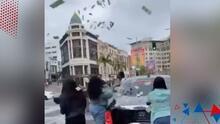 Rapero lanza dinero desde su auto en Beverly Hills y es multado por la policía