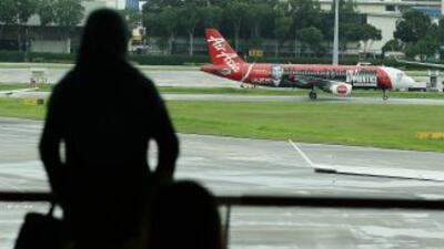 Diez miembros de una familia perdieron por error su vuelo de AirAsia